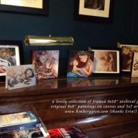 collector display of framed prints & original paintings