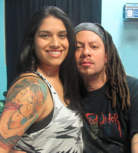 Stephanie with Rooster, the tattoo artist who inked her Crush tattoo